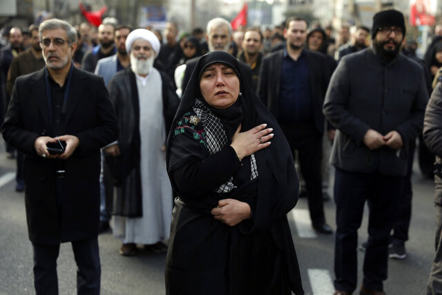 A woman mourns in a demonstration over the U.S. airstrike in Iraq that killed Iranian Revolutionary Guard Gen. Qassem Soleimani in Tehran, Iran, Jan. 3, 2020. Iran has vowed