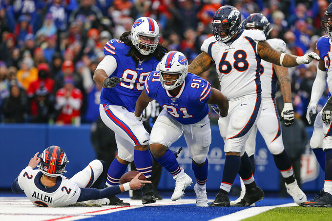 Buffalo Bills defensive tackle Ed Oliver (91) reacts after sacking Denver Broncos quarterback Brandon Allen (2) during the fourth quarter of an NFL football game, Sunday, Nov. 24, 2019, in Orchard Park, N.Y. (AP Photo/John Munson)