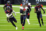 Tennessee Titans running back Derrick Henry (22) runs for a touchdown as Houston Texans' Jacob Martin (54) and Zach Cunningham (41) chase during the first half of an NFL football game, Sunday, Jan. 3, 2021, in Houston. (AP Photo/Eric Christian Smith)