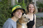 Jennifer Haller, right, the first person to receive a trial dose of a COVID-19 vaccine, poses for a photo with her son Hayden, 16, and their dog Meg, Sunday, July 19, 2020, in Seattle. As the world's biggest COVID-19 vaccine study gets underway more than four months after Haller and 44 others became the first participants in a phase-one coronavirus vaccine study that has produced encouraging results, Haller is encouraging other people to sign up for future trials. (AP Photo/Ted S. Warren)