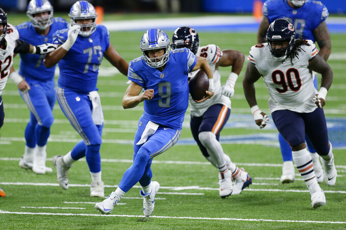 Detroit Lions quarterback Matthew Stafford (9) runs the ball against the Chicago Bears in the first half of an NFL football game in Detroit, Sunday, Sept. 13, 2020. (AP Photo/Duane Burleson)