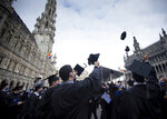 Engineering graduates of the Universite Libre De Bruxelles, throw their student caps in the air after a graduation ceremony at the Grand Place in Brussels, Wednesday, Sept. 30, 2020. Many of these students were supposed to graduate in June, but with exams cancelled and COVID-19 regulations in place many students were unable to manage that in time. Pandemic restrictions limited the guest invitations to only 2 persons for each graduate. (AP Photo/Virginia Mayo)