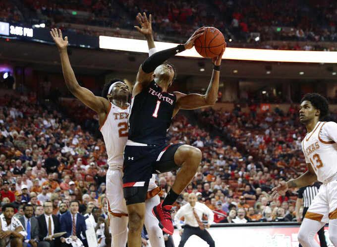 Texas Tech guard Terrence Shannon Jr. (1) drives to the basket past Texas forward Kai Jones (22) during the first half of an NCAA college basketball game, Saturday, Feb. 8, 2020, in Austin, Texas. (AP Photo/Eric Gay)
