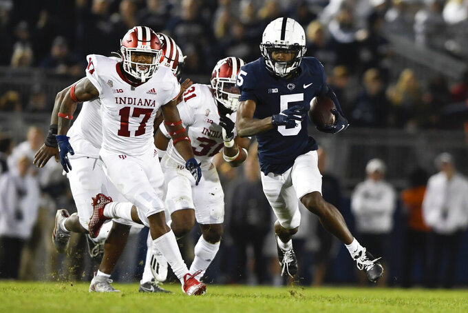Penn State returner Jahan Dotson (5) breaks away from Indiana's Jonathan Haynes (17) on a punt return during the fourth quarter of their NCAA college football game in State College, Pa., on Saturday, Oct. 2, 2021. Penn State defeated Indiana 24-0. (AP Photo/Barry Reeger)