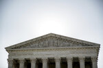 FILE - In this July 8, 2020, file photo the Supreme Court is shown in Washington. Liberal interest groups are intensifying pressure on Democrats to take aggressive measures to reshape the Supreme Court, arguing the party should include such measures in its policy platform at next month's convention. (AP Photo/Andrew Harnik, File)