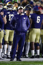 Notre Dame head coach Brian Kelly watches his team from the sideline as they play against Boston College during the second half of an NCAA college football game in South Bend, Ind., Saturday, Nov. 23, 2019. Notre Dame defeated Boston College 40-7. (AP Photo/Michael Conroy)