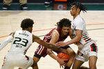 Miami guards Kameron McGusty (23) and Isaiah Wong, right, attempt to steal the ball from Boston College guard Makai Ashton-Langford during the second half of an NCAA college basketball game Friday, March 5, 2021, in Coral Gables, Fla. (AP Photo/Wilfredo Lee)