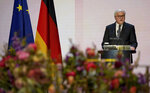 German President Frank-Walter Steinmeier delivers a speech during a memorial service in Berlin, Germany, Sunday, April 18, 2021 in remembrance of Germany's corona dead. (AP Photo/Michael Sohn, pool)
