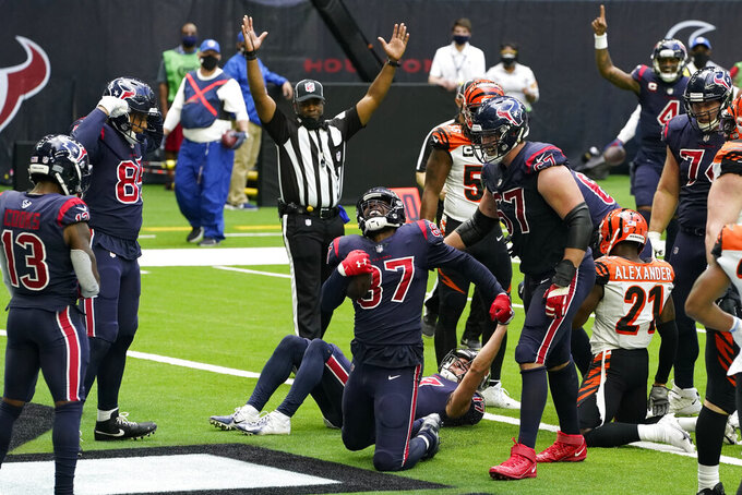 Houston Texans tight end Darren Fells (87) celebrates after a catch and run for a touchdown against the Cincinnati Bengals during the second half of an NFL football game Sunday, Dec. 27, 2020, in Houston. (AP Photo/Sam Craft)