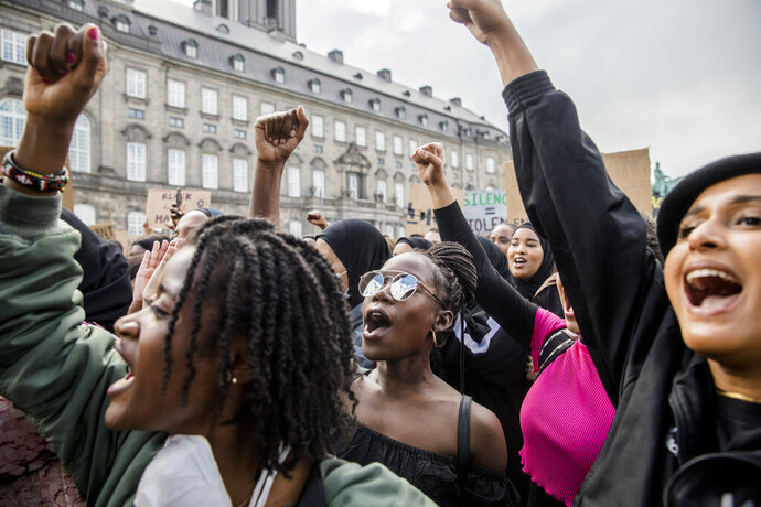FILE - Demonstrators take part in an anti-racism demonstration in Copenhagen, Denmark, Sunday, June 7, 2020, prompted by the recent death of black man George Floyd by a white police officer in USA.  Rights activists say racism exists in Denmark and have accused officials of being color-blind, saying race issues are not acknowledged or taken seriously by the authorities. (Nikolai Linares/Ritzau Scanpix FILE via AP)