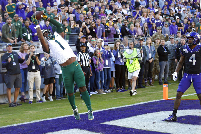 Baylor cornerback Grayland Arnold (1) intercepts the ball as TCU safety Keenan Reed (4) looks on to end the game in the third overtime of an NCAA college football game, Saturday, Nov. 9, 2019, in Fort Worth, Texas. Baylor won 29-23 in triple overtime. (AP Photo/Ron Jenkins)