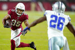 Arizona Cardinals wide receiver Rondale Moore (85) runs as Dallas Cowboys cornerback Jourdan Lewis (26) pursues during the first half of an NFL preseason football game, Friday, Aug. 13, 2021, in Glendale, Ariz. (AP Photo/Ross D. Franklin)