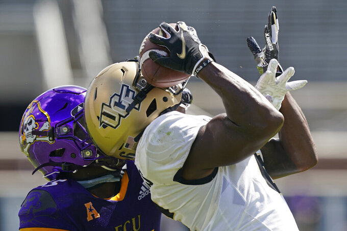 East Carolina defensive back Jireh Wilson, left, defends as Central Florida wide receiver Marlon Williams reaches for a pass during the first half of an NCAA college football game in Greenville, N.C., Saturday, Sept. 26, 2020. The pass fell incomplete. (AP Photo/Gerry Broome)
