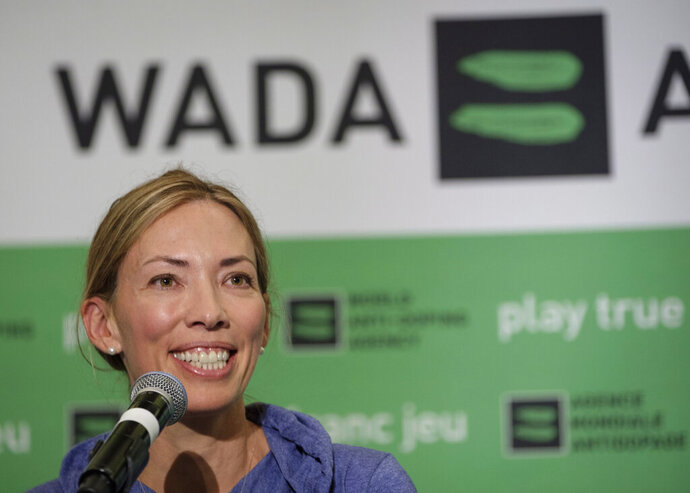 """FILE - In this June 5, 2018, file photo, Beckie Scott, World Anti-Doping Agency athlete committee chairperson, speaks at a news conference following the agency's first Global Athlete Forum in Calgary, Alberta One of her proudest accomplishments was getting an athlete charter of rights approved and into the WADA code book. That happened Thursday, Nov. 7, 2019, the last day of her term as chair. """"My hope is that going forward, voices that challenge or dissent will be heard and taken into consideration rather than undermined or dismissed,"""" Scott said in her speech. """"And my hope is that going forward, balance and independence will be restored to these tables, so that all interests and priorities here are aligned with equality of opportunity and fairness, rather than the business of sport."""". (Jeff McIntosh/The Canadian Press via AP, File)"""