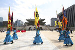 South Korean Imperial guards wearing face masks move during a reenactment of the Royal Guards Changing Ceremony, which had been suspended due to the new coronavirus, at Gyeongbok Palace in Seoul, South Korea, Thursday, May 21, 2020. (AP Photo/Ahn Young-joon)
