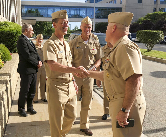Adm. John Richardson, chief of naval operations, arrives at the U.S. Naval War College in Newport, R.I., on Wednesday, June 12, 2019, to speak to students about leadership. He told The Associated Press that an investigation into allegations of mismanagement at the war college is continuing and he's confident the college will be stronger in the end. (AP Photo/ Jennifer McDermott)