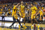 Missouri's Xavier Pinson, left, Mitchell Smith, center, and Tray Jackson, right, celebrate a foul called late in overtime of an NCAA college basketball game against Arkansas, Saturday, Feb. 8, 2020, in Columbia, Mo. Missouri beat Arkansas 83-79 in overtime. (AP Photo/L.G. Patterson)