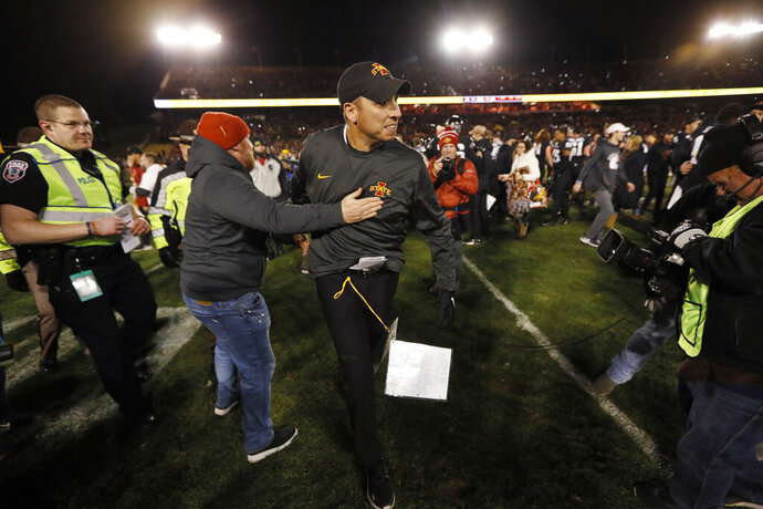 Iowa State head coach Matt Campbell, center, celebrates with fans after an NCAA college football game against Texas, Saturday, Nov. 16, 2019, in Ames, Iowa. Iowa State won 23-21. (AP Photo/Charlie Neibergall)