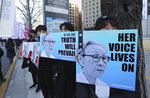 Mourners hold images of the deceased Kim Bok-dong, a former South Korean sex slave, during her funeral ceremony in Seoul, South Korea, Friday, Feb. 1, 2019. Hundreds of mourners gathered Friday near the Japanese Embassy for the funeral of Kim forced as a girl into a brothel and sexually enslaved by the Japanese military in WWII. (AP Photo/Ahn Young-joon)