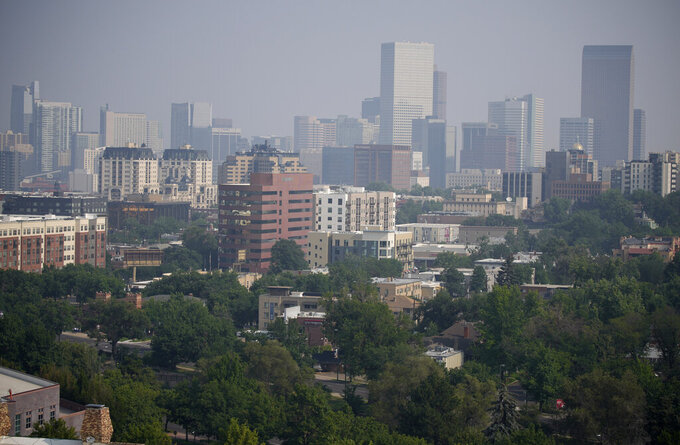 Smoke from western wildfires funnels along Colorado's Front Range and obscures the skyline Sunday, Aug. 8, 2021, in Denver. (AP Photo/David Zalubowski)