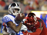 Kentucky wide receiver Isaiah Epps (81) tries to pull in a pass as Louisville defensive back Ori Jean-Charles (42) makes the hit during the second half of an NCAA college football game in Louisville, Ky., Saturday, Nov. 24, 2018. (AP Photo/Timothy D. Easley)