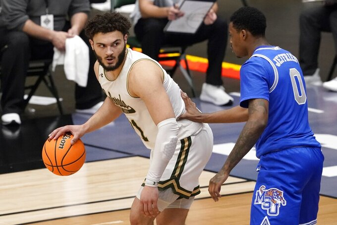Colorado State guard David Roddy (21) works against Memphis forward D.J. Jeffries (0) for a shot opportunity in the second half of an NCAA college basketball game in the semifinals of the NIT, Saturday, March 27, 2021, in Frisco, Texas. (AP Photo/Tony Gutierrez)