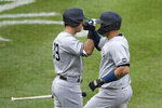 New York Yankees' Gary Sanchez, right, celebrates his home run with Mike Tauchman (39) during the second inning of the first baseball game of a doubleheader against the Baltimore Orioles, Friday, Sept. 4, 2020, in Baltimore. (AP Photo/Nick Wass)