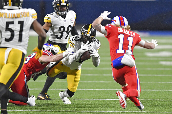 Pittsburgh Steelers cornerback Cameron Sutton (20) intercepts a pass during the first half of an NFL football game against the Buffalo Bills in Orchard Park, N.Y., Sunday, Dec. 13, 2020. (AP Photo/Adrian Kraus)