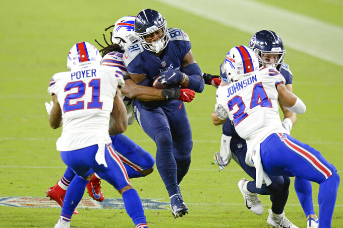 Tennessee Titans tight end Jonnu Smith (81) is stopped by Buffalo Bills middle linebacker Tremaine Edmunds (49) in the first half of an NFL football game Tuesday, Oct. 13, 2020, in Nashville, Tenn. (AP Photo/Mark Zaleski)