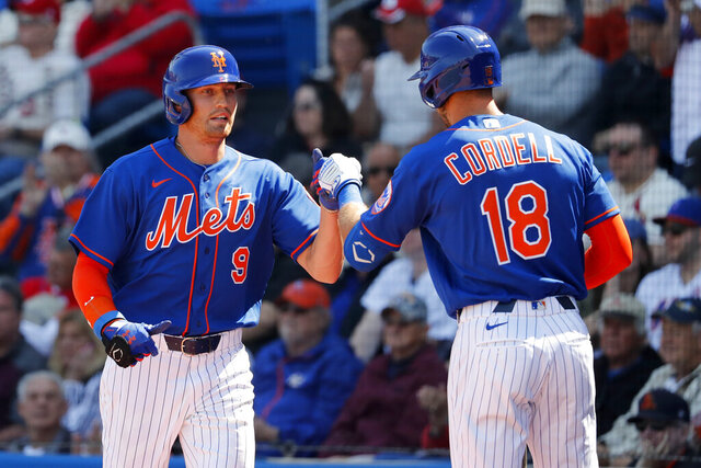 New York Mets' Brandon Nimmo (9) is congratulated by teammate Ryan Cordell (18) after scoring during the first inning of a spring training baseball game against the St. Louis Cardinals Friday, Feb. 28, 2020, in Port St. Lucie, Fla. (AP Photo/Jeff Roberson)