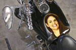 In this Nov. 1, 2019, photo, an image of Autumn Steele is shown painted on the tank of a motorcycle at the home of her husband, Gabe Steele, in West Point, Iowa. Autumn Steele was accidentally shot and killed by a Burlington, Iowa police officer in 2015. Accidental shootings by police happen across the United States every year, an Associated Press investigation has found, and experts say it's because law enforcement officers don't get the training they need. (AP Photo/Matthew Holst)