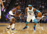 Sacramento Kings guard Buddy Hield, left, guards Charlotte Hornets guard Devonte' Graham, right, during the first quarter of an NBA basketball game in Sacramento, Calif., Wednesday, Oct. 30, 2019. (AP Photo/Rich Pedroncelli)