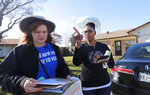 Democratic Party Precinct Chairs Angela Orr Heath, right, and Myla Senn prepare to walk a neighborhood during for a voter registration drive in Garland, Texas, Saturday, Jan. 18, 2020. Democrats are hoping this is the year they can finally make political headway in Texas and have set their sights on trying to win a majority in one house of the state Legislature. Among the hurdles they'll have to overcome are a series of voting restrictions Texas Republicans have implemented in recent years, including the nation's toughest voter ID law, purging of voter rolls and reductions in polling places. (AP Photo/LM Otero)