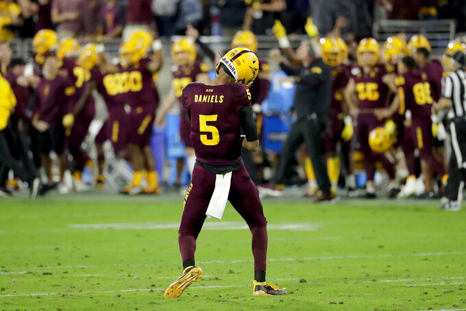 Arizona State quarterback Jayden Daniels (5) reacts toward the bench after throwing for an 81-yard touchdown against Oregon during the second half of an NCAA college football game Saturday, Nov. 23, 2019, in Tempe, Ariz. Arizona State won 31-28. (AP Photo/Matt York)