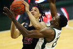Rutgers guard Caleb McConnell (22) is defended by Michigan State center Mady Sissoko (22) during the first half of an NCAA college basketball game, Tuesday, Jan. 5, 2021, in East Lansing, Mich. (AP Photo/Carlos Osorio)