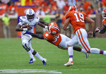 Furman quarterback JeMar Lincoln is pursued by Clemson's J.D.Davis, center, and Tanner Muse during the first half of an NCAA college football game Saturday, Sept. 1, 2018, in Clemson, S.C. (AP Photo/Richard Shiro)