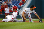 Baltimore Orioles third baseman Rio Ruiz, right, catches the throw from the outfield as Washington Nationals' Juan Soto slides into third base for a two-run triple during the first inning of a baseball game at Nationals Park on Wednesday, Aug. 28, 2019, in Washington. (AP Photo/Alex Brandon)