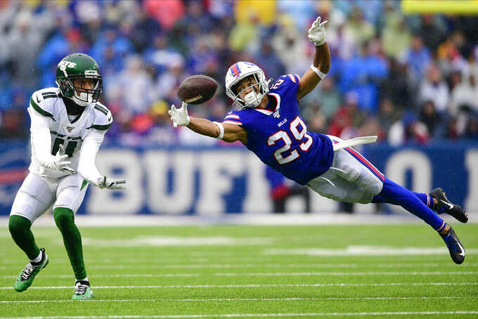 Buffalo Bills cornerback Kevin Johnson (29) defends a pass to New York Jets wide receiver Robby Anderson (11) during the first half of an NFL football game Sunday, Dec. 29, 2019, in Orchard Park, N.Y. (AP Photo/David Dermer)