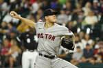 Boston Red Sox starting pitcher Tanner Houck throws against the Chicago White Sox during the first inning of a baseball game, Friday, Sept. 10, 2021, in Chicago. (AP Photo/David Banks)