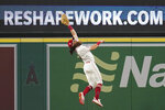 Los Angeles Angels center fielder Brandon Marsh (16) can't reach a sharp line drive hit by Texas Rangers' Nick Solak during the fourth inning of a baseball game Friday, Sep. 3, 2021, in Anaheim, Calif. Solak doubled. (AP Photo/Ashley Landis)