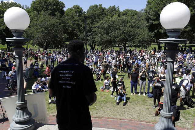 FILE - In this Sunday, June 14, 2020, file photo, Benjamin Watson, a former New England Patriots football player, front, addresses an audience in Boston during an event called
