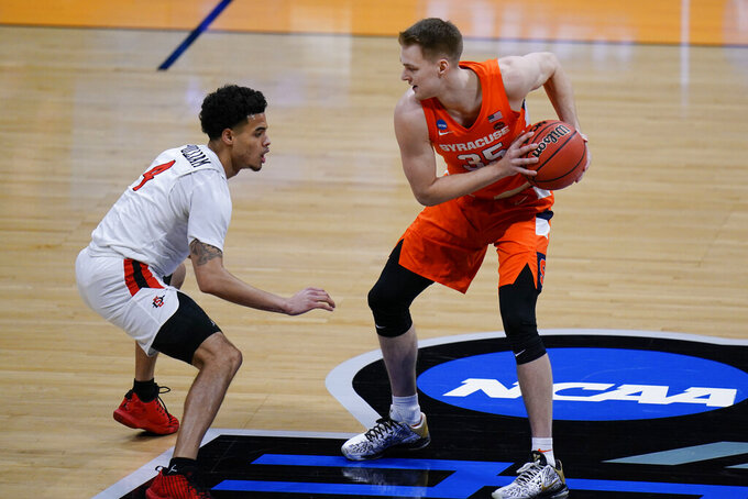 Syracuse guard Buddy Boeheim (35) is defended by San Diego State guard Trey Pulliam (4) during the first half of a college basketball game in the first round of the NCAA tournament at Hinkle Fieldhouse in Indianapolis, Friday, March 19, 2021. (AP Photo/AJ Mast)