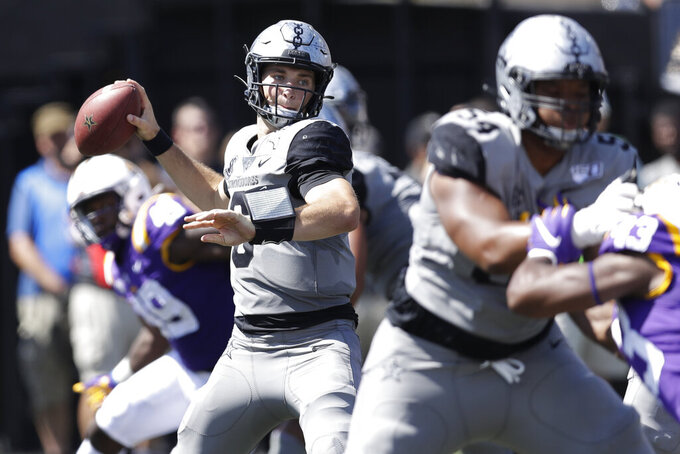 Vanderbilt quarterback Riley Neal (6) passes against LSU in the first half of an NCAA college football game Saturday, Sept. 21, 2019, in Nashville, Tenn. (AP Photo/Mark Humphrey)