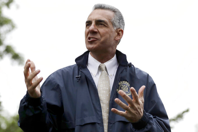 FILE - In this Monday, May 29, 2017, file photo, New Jersey Assemblyman Jack Ciattarelli, who is a Republican candidate in the gubernatorial primary election, speaks to a crowd during a Memorial Day observance, in Bridgewater, N.J. Democratic incumbent Gov. Phil Murphy is on an easy path toward capturing his party's nomination in the New Jersey primary on June 8, 2021. GOP candidate Ciattarelli is focusing his attacks on Murphy, but he faces competition from candidates embracing Trump. (AP Photo/Julio Cortez, File)
