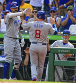 Chicago Cubs' Ian Happ, center, is congratulated by Nicholas Castellano, left,s and manager Joe Madden, right, after scoring a run in the eighth inning of a baseball game against the Pittsburgh Pirates, Saturday, Aug. 17, 2019, in Pittsburgh. (AP Photo/David Dermer)