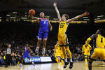 DePaul guard Devin Gage (3) drives to the basket ahead of Iowa forward Patrick McCaffery (22) during the first half of an NCAA college basketball game, Monday, Nov. 11, 2019, in Iowa City, Iowa. DePaul won 93-78. (AP Photo/Charlie Neibergall)