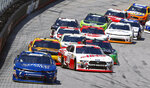 Ross Chastain (7) leads as Cole Custer (00) gets loose on a restart of a NASCAR Xfinity Series auto race on Saturday, April 14, 2018 in Bristol, Tenn. (AP Photo/Wade Payne)