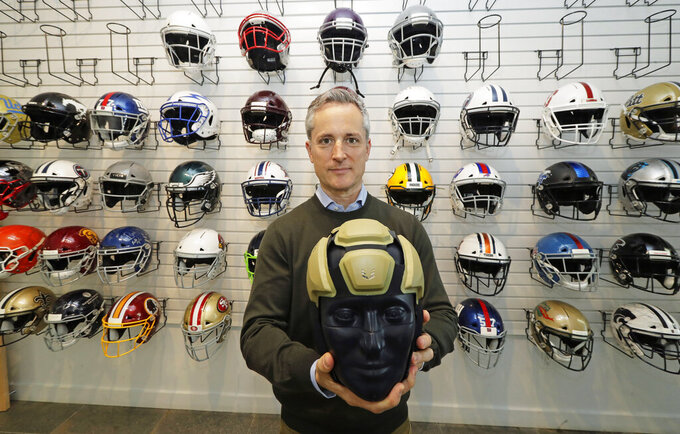 In this photo taken May 23, 2019, Dave Marver, CEO of VICIS, a Seattle-based company that makes football helmets, poses for a photo in Seattle as he holds the company's latest offering, the ULTIM cap. VICIS announced on Monday, July 1, the cap is intended for use with youth flag football and the quickly expanding competitive 7-on-7 football played during the offseason for youth and high school programs. (AP Photo/Ted S. Warren)