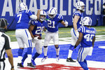 Indianapolis Colts' Jonathan Taylor (28) celebrates after running for a touchdown during the second half of an NFL football game against the Jacksonville Jaguars, Sunday, Jan. 3, 2021, in Indianapolis. (AP Photo/Michael Conroy)