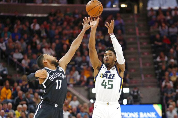 Utah Jazz guard Donovan Mitchell (45) shoots as Brooklyn Nets guard Garrett Temple (17) defends in the first half during an NBA basketball game Tuesday, Nov. 12, 2019, in Salt Lake City. (AP Photo/Rick Bowmer)